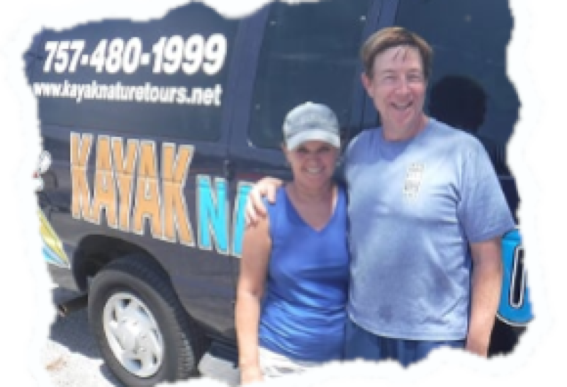 Randy and Bonita Gore Standing in front of the Kayak Nature Tours Van