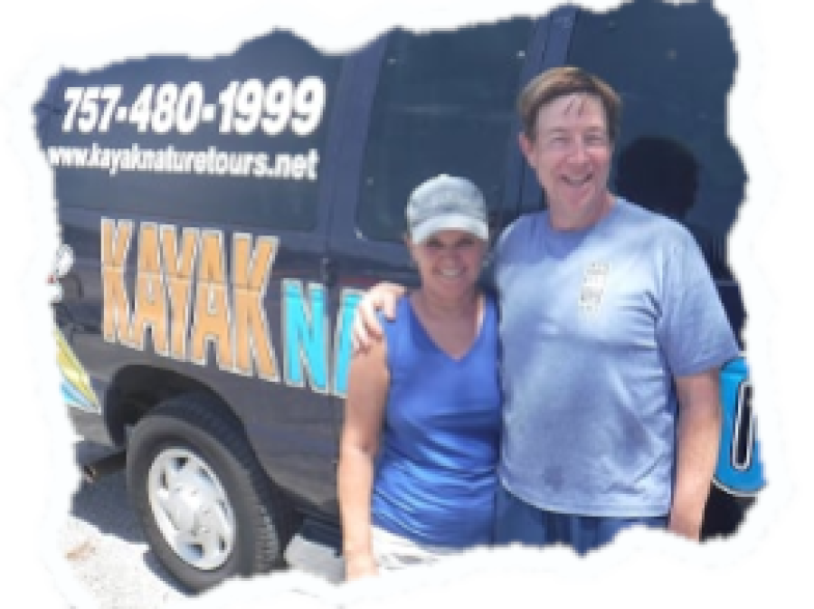 Randy and Bonita Gore Standing in front of the Kayak Nature Tours Van